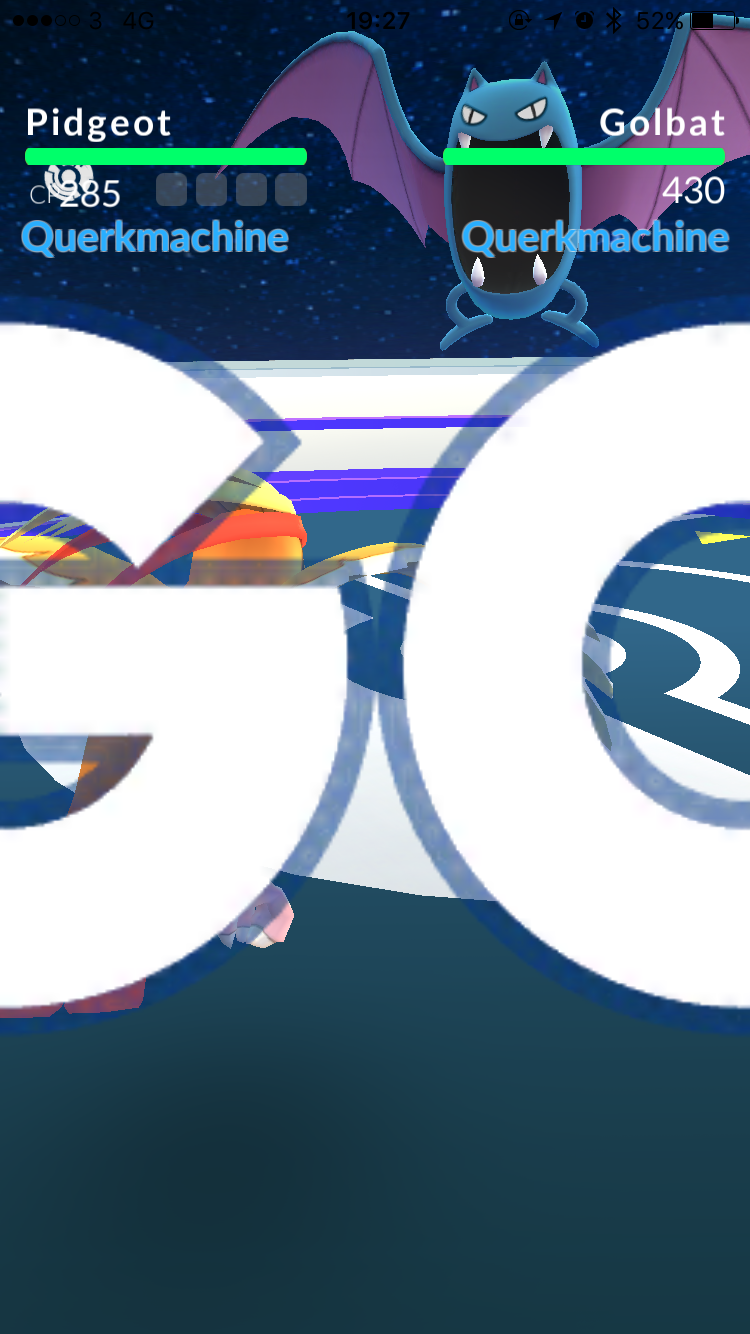 """A screenshot from Pokémon Go, showing a battle between a Pidgeot and a Golbat, with the word """"GO"""" drawn in huge letters across the middle of the image."""