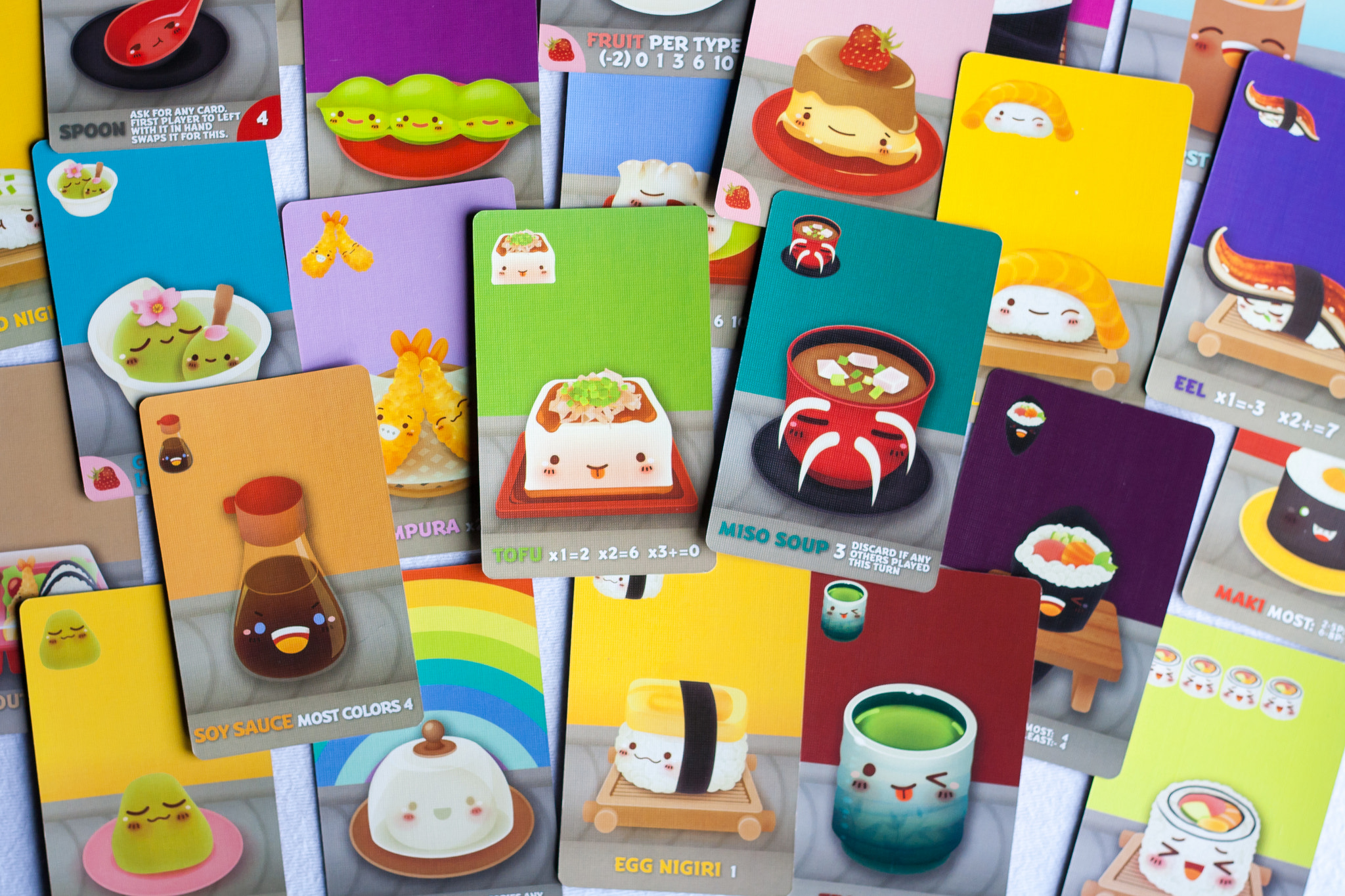 An assortment of game cards from the game Sushi Go Party, featuring anthropomorphised versions of common Japanese foods.