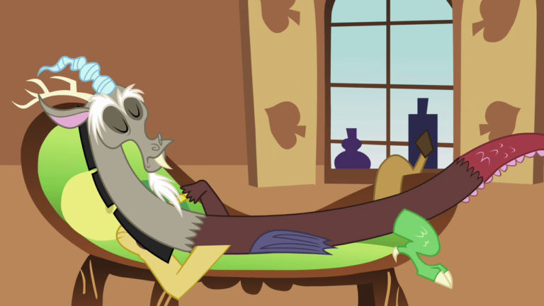 Discord laying haphazardly across a chaise lounge with his eyes closed.