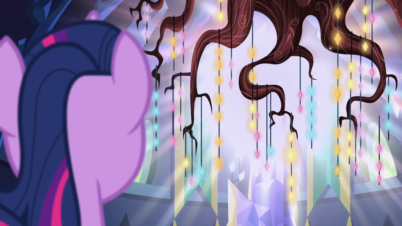 Twilight Sparkle looking at a chandelier made of various gems hanging from the roots of the former Golden Oaks Library tree.